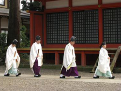 Priests walking in front of the shrine